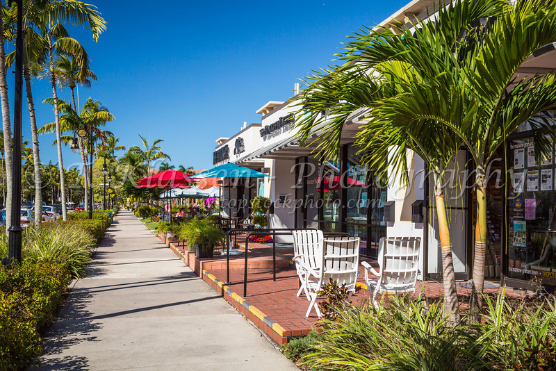 A view down 5th Ave. shops and restaurant in Naples, Florida, USA.