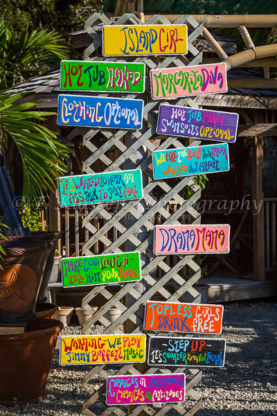 Name plaque signs at an outdoor garden center on the Florida Keys, USA.