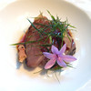 """Lightly smoked bonito in a tomato """"verjus"""" and topped with garlic (social garlic?)"""