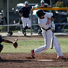 Woodlake Tiger SS Eddie Pena perpares to whack a pitch during the final of the Ron Robinson Baseball Classic. Woodlake beat Farmersville 5-4 to take the championship.