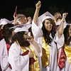 Lindsay High graduates sign the school alma mater after receiving their diplomas at the Lindsay High School Commencement on Friday, June 7, 2013.