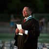 Lindsay High School Principal Jamie Robles beams with pride as his student enter Frank Skadan Stadium  during the LHS Commencement on June 7, 2013.