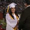 Lindsay High School graduate receives her diploma at the Cardinal Commencement on June 7, 2013.