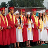 Linsday High School Top 10 students scholastically and Valedicatorian Charles Kreisel, at far left, are acknowledged during the Lindsay High School Commencement on June 7, 2013.