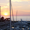 Sunset over the Cap-d'Ail Yacht Basin outside our room at the Marriott.  November 3, 2003