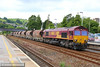66030 heads north through Totnes on the:<br /> 6Z55 13:10 St Blazey to Riverside<br /> <br /> 19/07/14