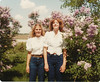 Linda Summer and Becky Warner.  Taken October, 1983 in front of lilacs, on mom and dad's farm.
