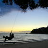 A sunset swing by the ocean at secluded Peach Cove, New Zealand