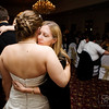 bride receives a hug from a guest