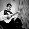 Groomsmen prepare, always time for music, Groomsman with mustache plays guitar