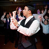 Groom throws garter