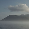 Volcano rises above the mist - Punta Vincente Roca