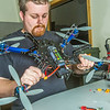"""Technician Michael Cook works on one of the unmanned aerial vehicles in UAF's Alaska Center for Unmanned Aircraft Systems Integration (ACUASI) shop in south Fairbanks.  <div class=""""ss-paypal-button"""">Filename: AAR-13-4026-82.jpg</div><div class=""""ss-paypal-button-end""""></div>"""