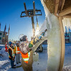 "Volunteers from GHEMM, Inc. use a crane to lift the buttresses for this year's student-built ice arch into position in Cornerstone Plaza on campus. The annual ice arch is designed and built by a team of engineering students, a UAF tradition going back more than 60 years.  <div class=""ss-paypal-button"">Filename: AAR-14-4078-35.jpg</div><div class=""ss-paypal-button-end""></div>"