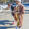 "Brian Tuohy, playing the title role in Theatre UAF's production of ""Tartuffe,"" (left) and Sambit Misra, playing Orgon, walk across campus before performing a live teaser in Wood Center a couple of days before opening night.  Filename: AAR-14-4121-26.jpg"