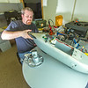 """Technician Michael Cook works on one of the unmanned aerial vehicles in UAF's Alaska Center for Unmanned Aircraft Systems Integration (ACUASI) shop in south Fairbanks.  <div class=""""ss-paypal-button"""">Filename: AAR-13-4026-71.jpg</div><div class=""""ss-paypal-button-end""""></div>"""
