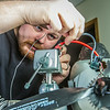 """Technician Michael Cook works on one of the unmanned aerial vehicles in UAF's Alaska Center for Unmanned Aircraft Systems Integration (ACUASI) shop in south Fairbanks.  <div class=""""ss-paypal-button"""">Filename: AAR-13-4026-56.jpg</div><div class=""""ss-paypal-button-end""""></div>"""