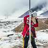 """Professor Regine Hock, a glaciologist with UAF's Geophysical Institute, measure the depth of the ice near the toe of the Jarvis Glacier in the eastern Alaska Range.  <div class=""""ss-paypal-button"""">Filename: AAR-14-4256-457.jpg</div><div class=""""ss-paypal-button-end""""></div>"""