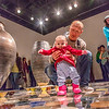Patrons of all ages walked around on the ceramic artwork produced by Ian Wilkinson for his BFA thesis during the opening of his show in the gallery in the UAF Fine Arts Complex.  Filename: AAR-13-3780-380.jpg