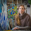 Art major Klara Maisch poses in front of one of her paintings in the Fine Arts studio.  Filename: AAR-12-3299-38.jpg