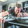 """Technician Michael Cook works on one of the unmanned aerial vehicles in UAF's Alaska Center for Unmanned Aircraft Systems Integration (ACUASI) shop in south Fairbanks.  <div class=""""ss-paypal-button"""">Filename: AAR-13-4026-142.jpg</div><div class=""""ss-paypal-button-end""""></div>"""