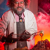 Geology professor Rainer Newberry pours hot lava over volcanic basalt during a set-up photoshoot in a Reichardt Building lab in on the Fairbanks campus.  Filename: AAR-13-3732-34.jpg
