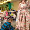 Assistant professor Bethany Marx marks the hem of a dress worn by theatre major Katrina Kuharich for the Theatre UAF production of Tartuffe in the department's costume shop. Marx designed all the costumes for the show.  Filename: AAR-14-4104-69.jpg