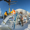 "Volunteers from GHEMM, Inc. use a crane to lift the buttresses for this year's student-built ice arch into position in Cornerstone Plaza on campus. The annual ice arch is designed and built by a team of engineering students, a UAF tradition going back more than 60 years.  <div class=""ss-paypal-button"">Filename: AAR-14-4078-42.jpg</div><div class=""ss-paypal-button-end""></div>"