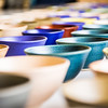 A few of the 1,200 ceramic bowls made by art major Ian Wilkinson as part of his 2013 senior thesis.  Filename: AAR-13-3770-11.jpg