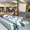 """Technician Michael Cook works on one of the unmanned aerial vehicles in UAF's Alaska Center for Unmanned Aircraft Systems Integration (ACUASI) shop in south Fairbanks.  <div class=""""ss-paypal-button"""">Filename: AAR-13-4026-127.jpg</div><div class=""""ss-paypal-button-end""""></div>"""