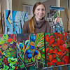 Art major Klara Maisch poses with some of her paintings in the Fine Arts studio.  Filename: AAR-12-3299-43.jpg