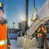 """Tripp Collier, one of the project managers for this year's student ice arch, works woth other students and a volunteer from GHEMM Co., to raise the first of four buttresses used in the creative design.  <div class=""""ss-paypal-button"""">Filename: AAR-14-4078-26.jpg</div><div class=""""ss-paypal-button-end""""></div>"""
