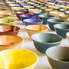 A few of the 1,200 ceramic bowls made by art major Ian Wilkinson as part of his 2013 senior thesis.  Filename: AAR-13-3770-15.jpg
