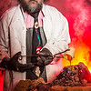 Geology professor Rainer Newberry pours hot lava over volcanic basalt during a set-up photoshoot in a Reichardt Building lab in on the Fairbanks campus.  Filename: AAR-13-3732-22.jpg