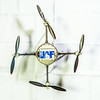 """One of the unmanned aerial vehicles being used for various research activites bears the UAF logo on its battery case.  <div class=""""ss-paypal-button"""">Filename: AAR-13-4026-112.jpg</div><div class=""""ss-paypal-button-end""""></div>"""