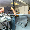 """Technician Michael Cook works on one of the unmanned aerial vehicles in UAF's Alaska Center for Unmanned Aircraft Systems Integration (ACUASI) shop in south Fairbanks.  <div class=""""ss-paypal-button"""">Filename: AAR-13-4026-135.jpg</div><div class=""""ss-paypal-button-end""""></div>"""