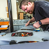 """Technician Michael Cook works on one of the unmanned aerial vehicles in UAF's Alaska Center for Unmanned Aircraft Systems Integration (ACUASI) shop in south Fairbanks.  <div class=""""ss-paypal-button"""">Filename: AAR-13-4026-134.jpg</div><div class=""""ss-paypal-button-end""""></div>"""