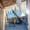 "Volunteers from GHEMM, Inc. use a crane to lift the buttresses for this year's student-built ice arch into position in Cornerstone Plaza on campus. The annual ice arch is designed and built by a team of engineering students, a UAF tradition going back more than 60 years.  <div class=""ss-paypal-button"">Filename: AAR-14-4078-9.jpg</div><div class=""ss-paypal-button-end""></div>"