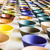 A few of the 1,200 ceramic bowls made by art major Ian Wilkinson as part of his 2013 senior thesis.  Filename: AAR-13-3770-13.jpg