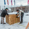 "Engineering majors Tripp Collier, left, and Andy Chamberlain measure placement for the forms used to hold the foundation during initial contruction of the 2014 ice arch, a tradition on the UAF campus for more than 50 years.  <div class=""ss-paypal-button"">Filename: AAR-14-4031-45.jpg</div><div class=""ss-paypal-button-end""></div>"
