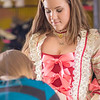 Assistant professor Bethany Marx works on finishing some details on a dress worn by theatre major Katrina Kuharich for the Theatre UAF production of Tartuffe in the department's costume shop. Marx designed all the costumes for the show.  Filename: AAR-14-4104-132.jpg