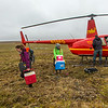 "Ph.D candidate Ludda Ludwig, left, and graduate student Kelsey Blake from the University of Victoria in British Columbia, unload a helicopter after a short flight from the Toolik Field Station to their research site near the headwaters of the Kuparuk River. Ludwig's study is focused on the movement of water and nutrients from Arctic hillslopes to streams. The Toolik research facility, located about 330 miles north of Fairbanks on Alaska's North Slope, is operated by UAF's Institute of Arctic Biology.  <div class=""ss-paypal-button"">Filename: AAR-14-4217-030.jpg</div><div class=""ss-paypal-button-end""></div>"