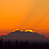 The sun sets behind Mt. McKinley seen from an Eielson Building window on the Fairbanks campus.