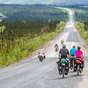"Cyclists make their way along a lonely stretch of the Dalton Highway which mostly parallels the trans-Alaska pipeline from just north of Fairbanks to Deadhorse near the Arctic Ocean.  <div class=""ss-paypal-button"">Filename: AKA-14-4213-044.jpg</div><div class=""ss-paypal-button-end""></div>"