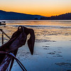 An anchor contrasts with ice on the water at sunset at the Auke Bay harbor near Juneau.  Filename: AKA-14-4059-297.jpg