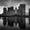 Dark Financial Skies Monochrome, long Exposure sunset over Canary Wharf as seen from Poplar Dock