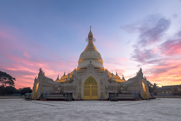 Photograph: Yangon Sunrise - Sunrise at the Maha Wizaya Pagoda in Yangon, Myanmar.