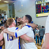 Nanooks gather near mid-court to celebrate beating the UAA Seawolves on a last-second shot by Andrew Kelly on Senior Night in the Patty Gym.  Filename: ATH-14-4097-86.jpg
