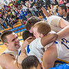 Senior Andrew Kelly is mobbed by his teammates moments after scoring at the buzzer to lead the Nanooks to an incredible come-from-behind victory over the UAA Seawolves on Senior Night in the Patty Gym.  Filename: ATH-14-4097-49.jpg