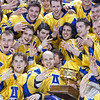 The UAF hockey team huddles around the Governor's Cup on the ice in the Carlson Center after their thrilling victory over the UAA Seawolves to claim the coveted trophy for the third time in the past four years.  Filename: ATH-12-3304-338.jpg